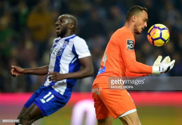 Maritimo's Brazilian goalkeeper Charles Silva catches a ball next to Porto's Malian forward Moussa Marega during the Portuguese league football match...
