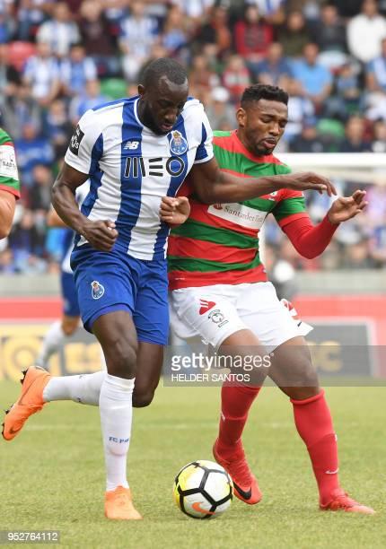 Maritimo's Brazilian midfielder Jean Cleber challenges Porto's Malian forward Moussa Marega during the Portuguese league football match between...