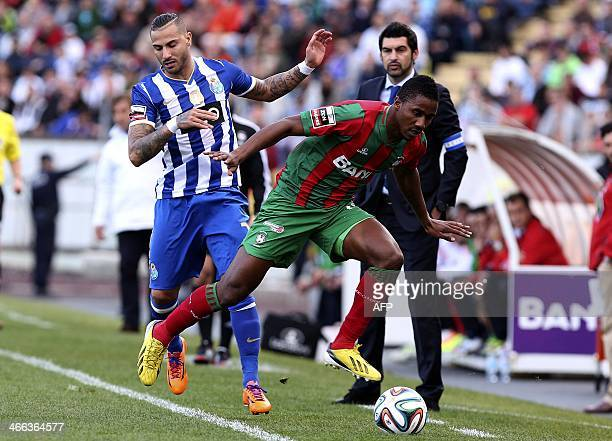 Maritimo's Cape Verdean defender Admilson de Barro 'Gege' vies with Porto's forward Ricardo Quaresma during the Portuguese league football match CS...