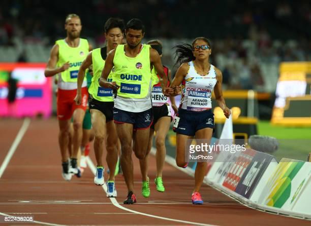 Maritza Arango Buitrago of Columbia and Guide Jonathan Daybes Sanchez Gonzalez compete Women's 1500m T11 Final during World Para Athletics...