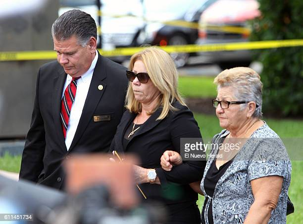 Maritza Fernandez the mother of Miami Marlins pitcher Jose Fernandez center and Olga Fernandez his grandmother right before a memorial service at St...
