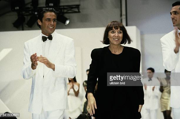 Mariuccia Mandelli fashion designer Italy with male models on the catwalk after the presentation of the collection 1989