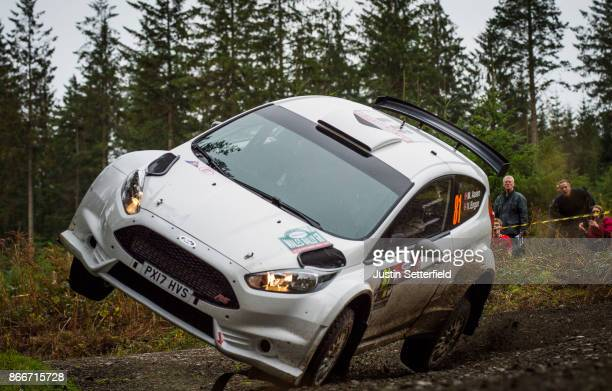 Marius Aasen of Norway drives with codriver Veronica Engan of Norway during the FIA World Rally Championship Great Britain Shakedown on October 26...