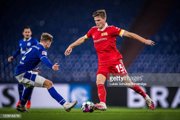 Marius Bülter of Berlin and Kilian Ludewig of Schalke in action during the Bundesliga match between FC Schalke 04 and 1. FC Union Berlin at...