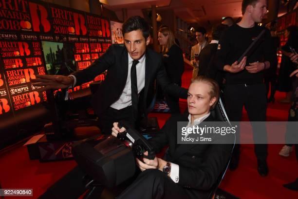 Marius Borg H¿iby Crown Princess of Norway's Son tries to beat Panasonic Jaguar Racing Formula E driver Mitch Evans' lap time on Formula E simulators...