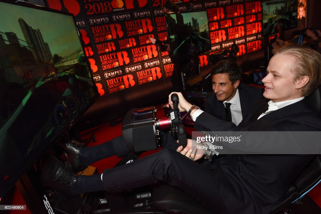 Marius Borg H¿iby Crown Princess of Norway's Son tries to beat Panasonic Jaguar Racing Formula E driver Mitch Evans' lap time on Formula E simulators during The BRIT Awards 2018 after-party, hosted by Tempus magazine, at The Intercontinental Hotel, The o2, on February 21, 2018 in London, England.