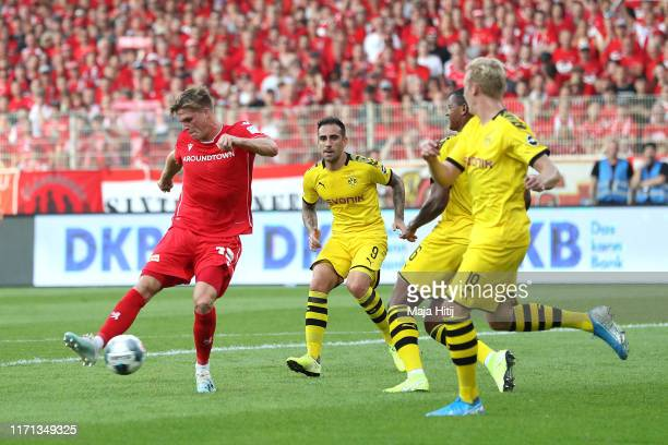 Marius Bulter of FC Union Berlin scores his team's first goal during the Bundesliga match between 1 FC Union Berlin and Borussia Dortmund at Stadion...