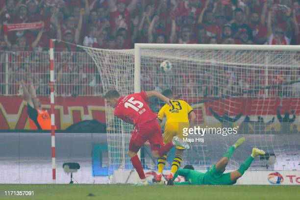 Marius Bulter of FC Union Berlin scores his team's second goal during the Bundesliga match between 1. FC Union Berlin and Borussia Dortmund at...