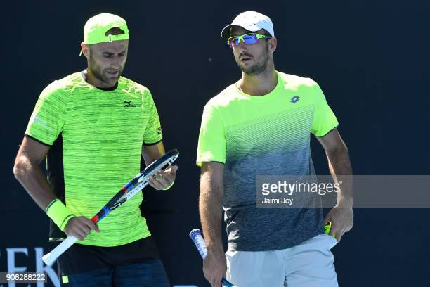 Marius Copil of Romania and Viktor Troicki of Serbia compete in their first round men's doubles match against Rajeev Ram of the United States and...