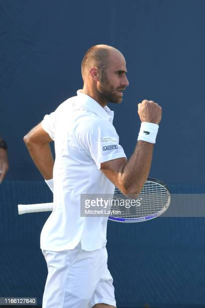 Marius Copil of Romania celebrates a shot from Mikael Torpegaard of Denmark during Day 1 of the Citi Open at Rock Creek Tennis Center on July 29,...