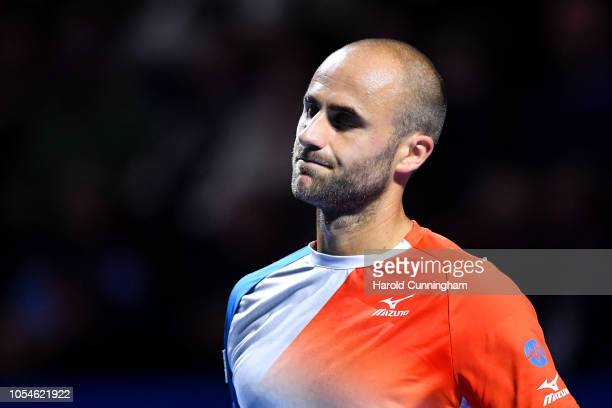 Marius Copil of Romania grimaces during the final match of the Swiss Indoors ATP 500 tennis tournament against of Roger Federer of Switzerland at St...
