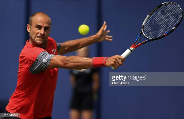 Marius Copil of Romania hits a backhand during his match against John Millman during qualifying Day 2 of the Fever-Tree Championships at Queens Club...