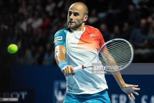 Marius Copil of Romania hits the ball during the Swiss Indoors Basel final tennis match between Roger Federer and Marius Copil at St Jakobshalle on...