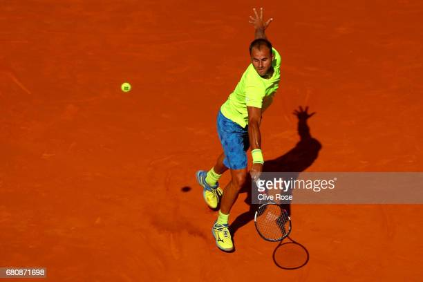 Marius Copil of Romania in action against Andy Murray of Great Britain during day four of the Mutua Madrid Open tennis at La Caja Magica on May 9,...