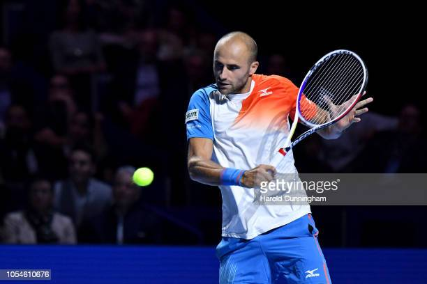 Marius Copil of Romania in action during the final match of the Swiss Indoors ATP 500 tennis tournament against of Roger Federer of Switzerland at St...
