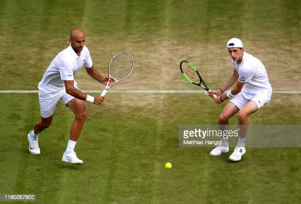 Marius Copil of Romania, playing partner of Ugo Humbert of France plays a backhand during their Men's Doubles first round match against Andy Murray...