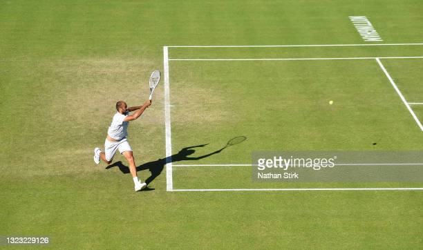 Marius Copil of Romania plays a backhand against Frances Tiafore of United States during the men's semi-finals match on day eight of the Viking Open...