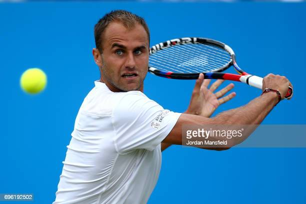 Marius Copil of Romania plays a backhand during his Men's second round match against Reilly Opelka of the USA during day four of the Aegon Open...