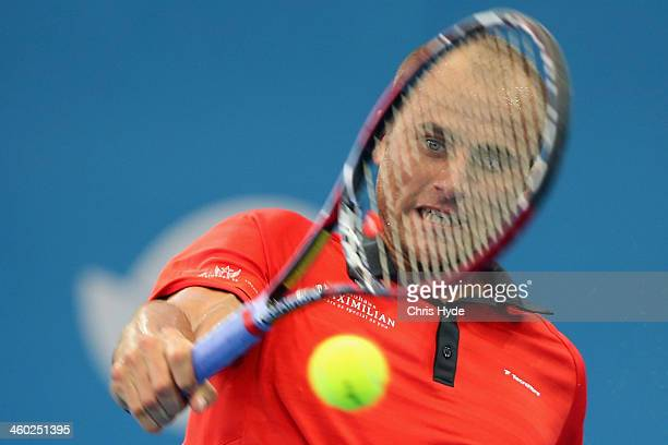 Marius Copil of Romania plays a backhand in his match against Lleyton Hewitt of Australia during day six of the 2014 Brisbane International at...
