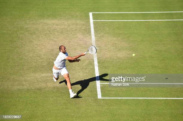 Marius Copil of Romania plays a forekhand shot against Frances Tiafore of United States during the men's semi-finals match on day eight of the Viking...