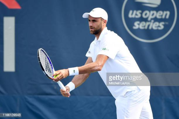 Marius Copil of Romania prepares to serve to Mikael Torpegaard of the Denmark during Day 1 of the Citi Open at Rock Creek Tennis Center on July 29,...