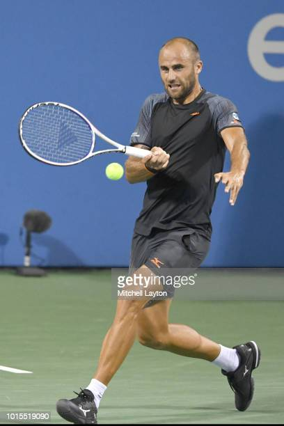 Marius Copil of Romania returns a backhand shot to Andy Murray of Great Britian during Day Six of the Citi Open at the Rock Creek Tennis Center on...