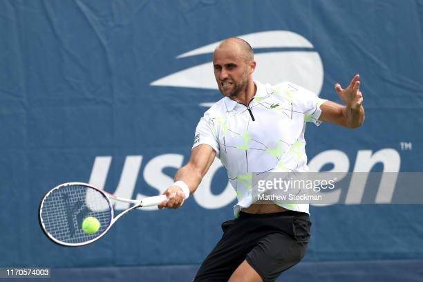 Marius Copil of Romania returns a shot against Ugo Humbert of France during their Men's Singles first round match on day two of the 2019 US Open at...