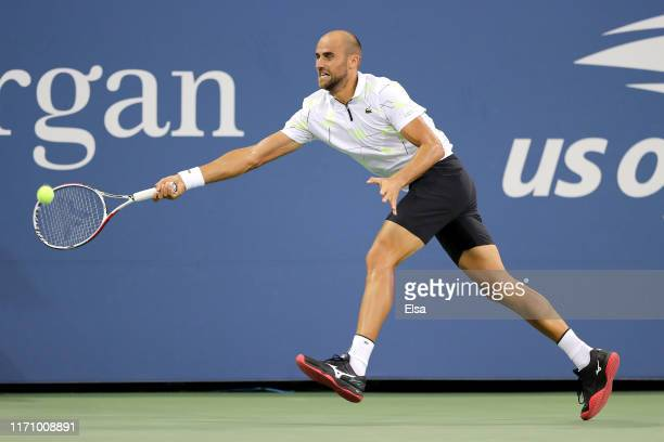 Marius Copil of Romania returns a shot during his Men's Singles second round match against Gael Monfils of France on day four of the 2019 US Open at...