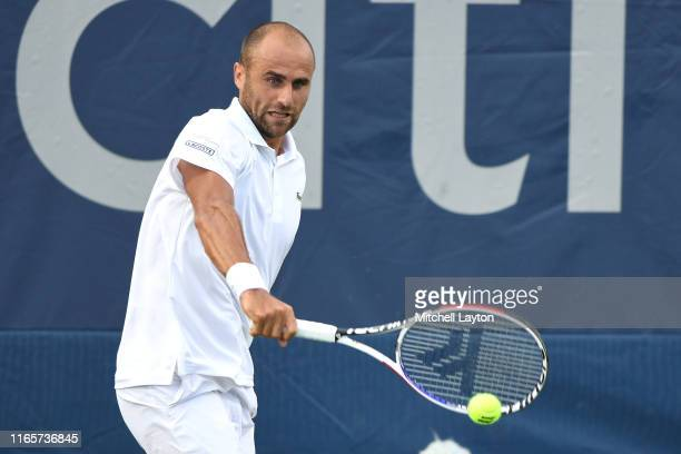 Marius Copil of Romania returns a shot from Marin Cilic of Croatia during Day 2 of the Citi Open at Rock Creek Tennis Center on July 30, 2019 in...