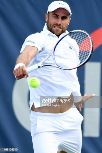 Marius Copil of Romania returns a shot from Mikael Torpegaard of Denmark during Day 1 of the Citi Open at Rock Creek Tennis Center on July 29, 2019...
