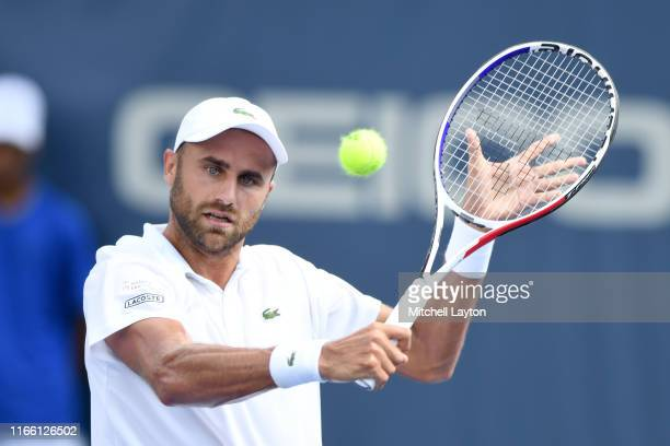 Marius Copil of Romania returns a shot from Mikael Torpegaard of the Denmark during Day 1 of the Citi Open at Rock Creek Tennis Center on July 29,...