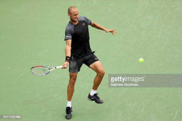 Marius Copil of Romania returns a shot to Marin Cilic of Croatia during the Western & Southern Open at Lindner Family Tennis Center on August 15,...