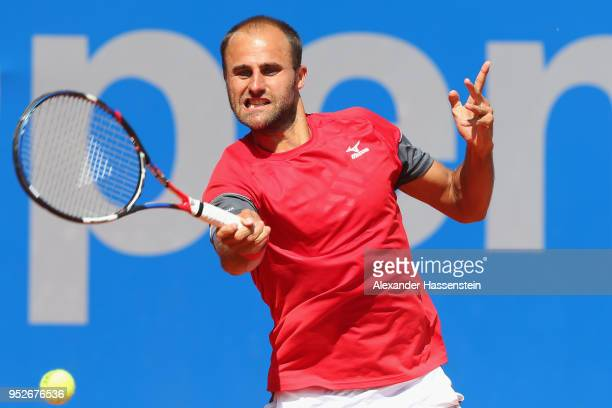 Marius Copil of Rumania plays a fore hand during his qualification match against Andrej Martin of Slovakia on day 2 of the BMW Open at MTTC IPHITOS...