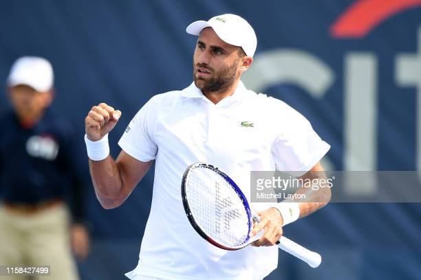 Marius Copil of the Romania celebrates a shot from Mikael Torpegaard of the Denmark during Day 1 of the Citi Open at Rock Creek Tennis Center on July...