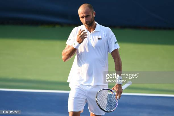Marius Copil of the Romania looks on during a match against Mikael Torpegaard of the Denmark during Day 1 of the Citi Open at Rock Creek Tennis...