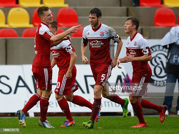 Marius Duhnke of Unterhaching celebrates his team's first goal with teammates during the third Bundesliga match between SV Elversberg and SpVgg...