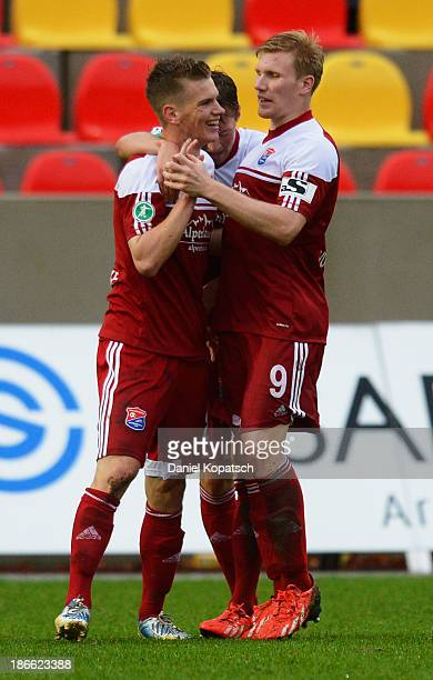 Marius Duhnke of Unterhaching celebrates their first goal with teammate Andreas Voglsammer during the third Bundesliga match between SV Elversberg...