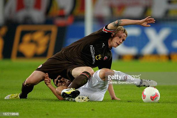 Marius Ebbers of St Pauli and Jonas Hector of Cologne battle for the ball during the Second Bundesliga match between 1 FC Koeln and FC St Pauli at...