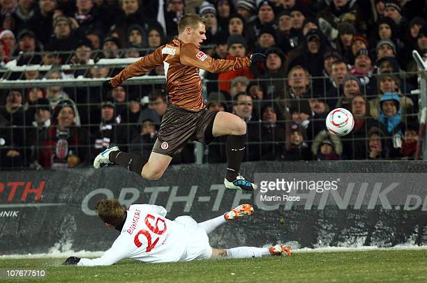 Marius Ebbers of St. Pauli and Niko Bungert of Mainz battle for the ball during the Bundesliga match between FC St. Pauli and FSV Mainz 05 at...