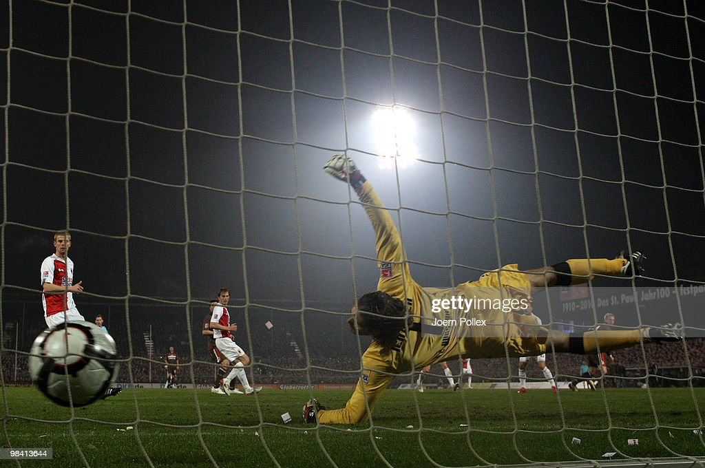 Marius Ebbers (R) of St. Pauli scores his team's second goal during the Second Bundesliga match between FC St. Pauli and FC Augsburg at the Millerntor Stadium on April 12, 2010 in Hamburg, Germany.