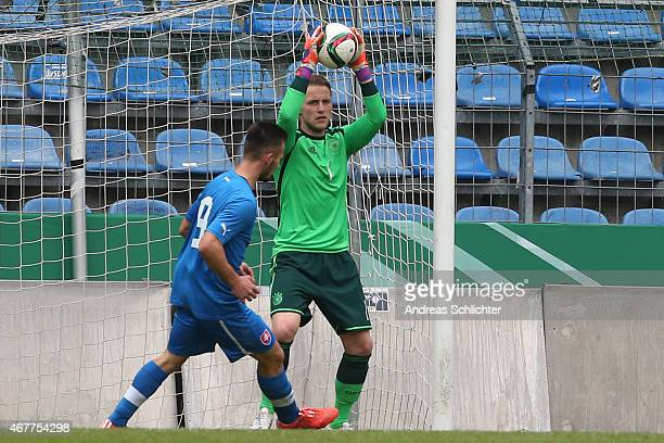 Marius Funk of Germany challenges Tomas Vestenicky of Slovakia during the UEFA Under19 Elite Round match between U19 Germany and U19 Slovakia at...