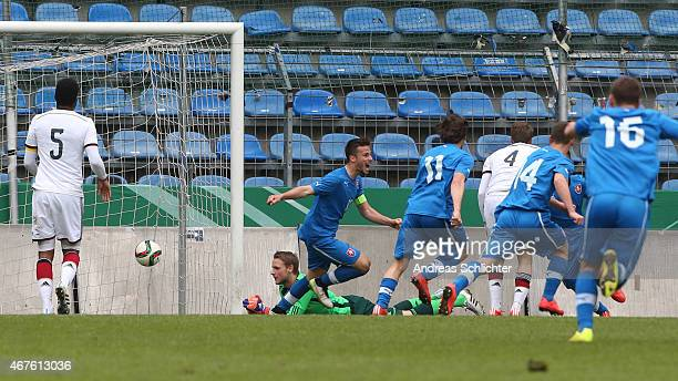 Marius Funk of Germany fails to stop Tomas Vestenicky of Slovakia's first goal during the UEFA Under19 Elite Round match between U19 Germany and U19...