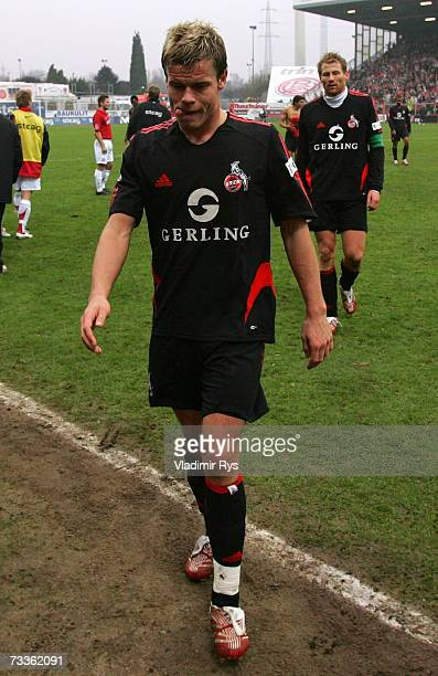 Marius Johnsen and his team mate Lukas Sinkiewicz of Cologne leave the pitch after losing 50 the Second Bundesliga match between Rot Weiss Essen and...