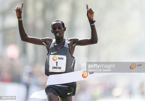 Marius Kimutai of Kenya crosses the finish line to win the men's race of the 37th edition of the Rotterdam Marathon in Rotterdam on April 9 2017 /...
