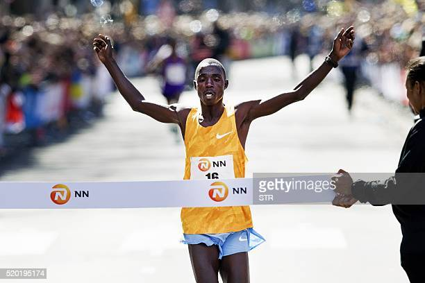 Marius Kipserem from Kenya crosses the finish line to win the men's race of the Rotterdam Marathon in Rotterdam April 10 2016 / AFP / ANP / STR /...