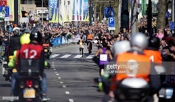 Marius Kipserem from Kenya crosses the finish line to win the men's race of the Rotterdam Marathon in Rotterdam on April 10 2016 / AFP / ANP / OLAF...