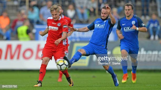 Marius Kleinsorge of Meppen tackles Patrick Schorr of Aalen during the 3 Liga match between SV Meppen and VfR Aalen at Haensch Arena on September 10...