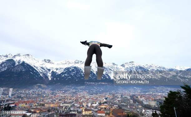 Marius Lindvik from Norway soars through the air during his training jump of the Four-Hills Ski Jumping tournament third phase on January 3, 2020 in...