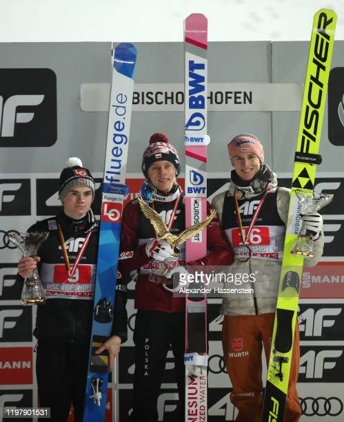 Marius Lindvik of Norway Dawid Kubacki of Poland and Karl Geiger of Germany celebrates during the prize giving ceremony after the 68th FIS Nordic...