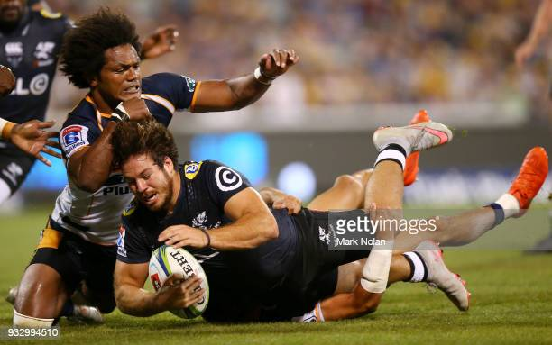 Marius Louw of the Sharks is tackled just short of the line during the round five Super Rugby match between the Brumbies and the Sharks at GIO...